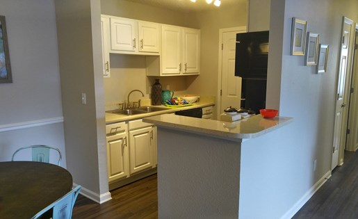 Galley-style kitchen, all black appliance package