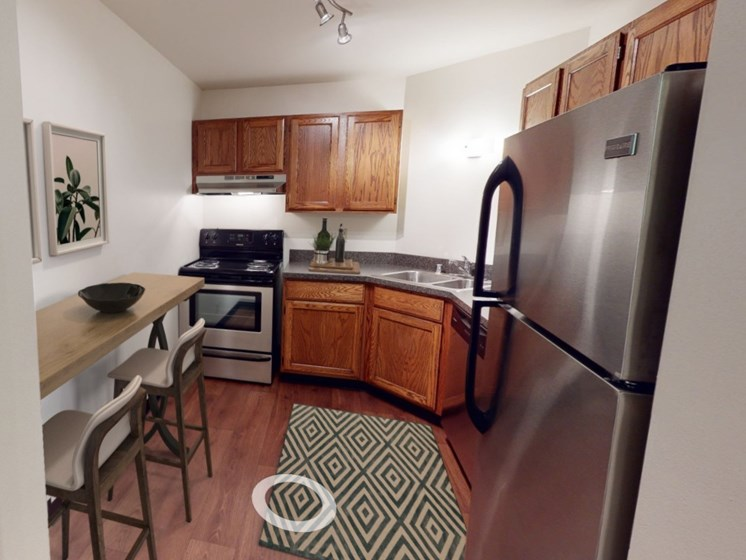 Aspen kitchen with newer stainless steel appliances.