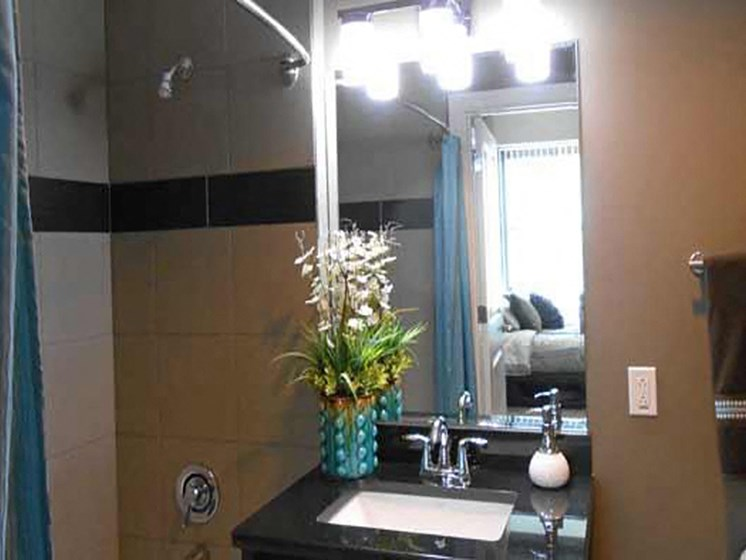 Renovated Bathrooms With Quartz Counters at The Residences At Hanna, Cleveland, OH
