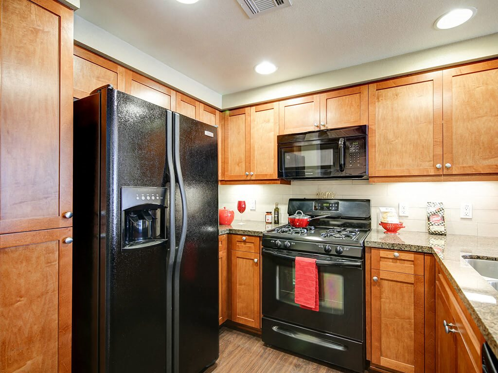 Gourmet Kitchen with Breakfast Bar and Pantry at Ontario Town Square Townhomes, 380 East Bluebird Privado, CA