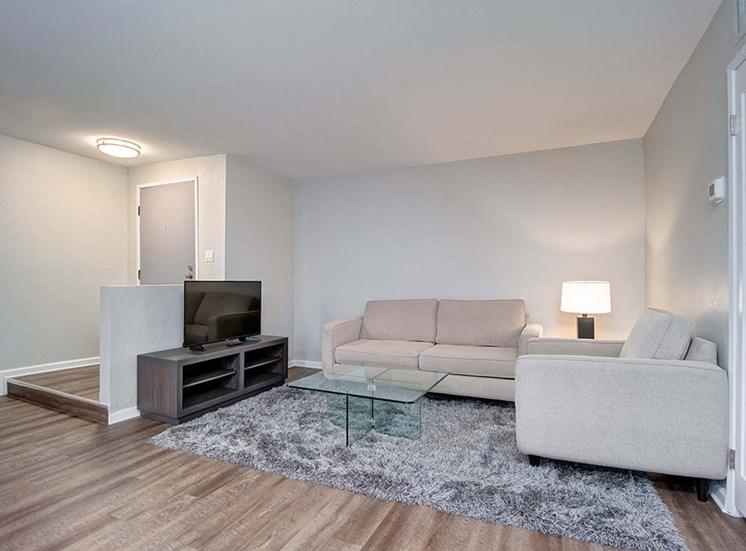 TV, Sofa In Living Room at El Patio Apartments, Glendale, CA, 91207