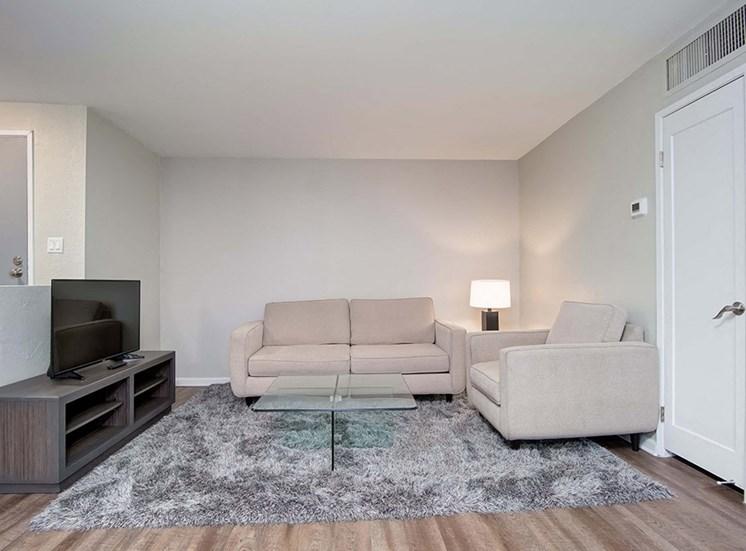 TV, Sofa, Table Lamp In Living Room at El Patio Apartments, Glendale, CA
