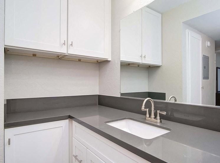 Bathroom with vanity sink at El Patio Apartments, California, 91207