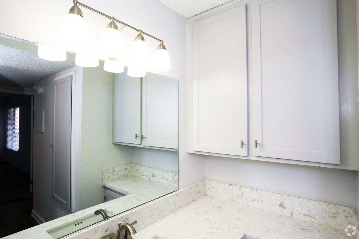 Vanity outside bathroom with extra storage