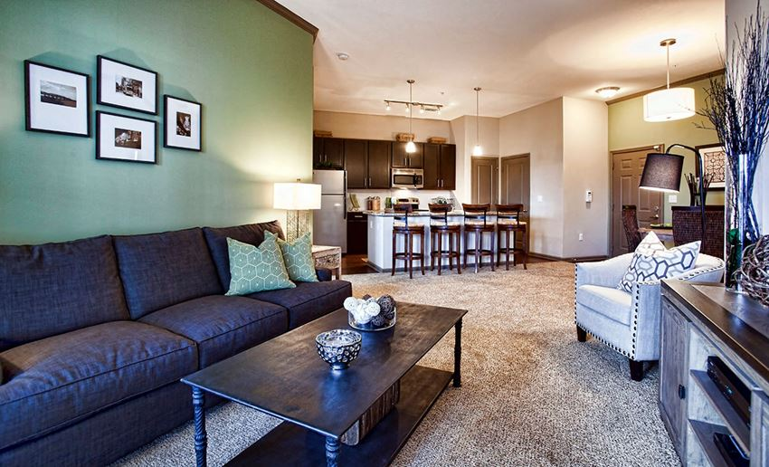 Spacious, open apartment floor plan with plush carpet in living and dining areas