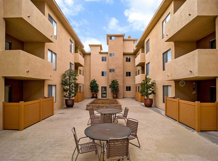 Courtyard with Chairs and Table at Los Robles Apartments, Pasadena