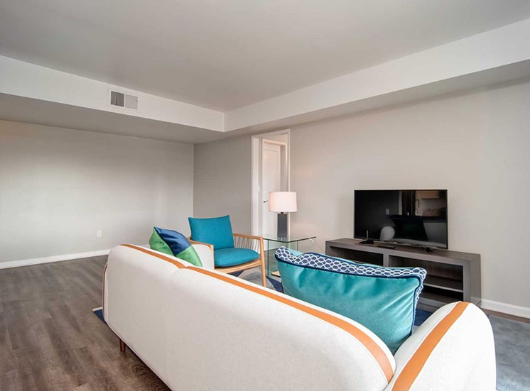 TV, White Sofa In Living Room at Los Robles Apartments, Pasadena, California