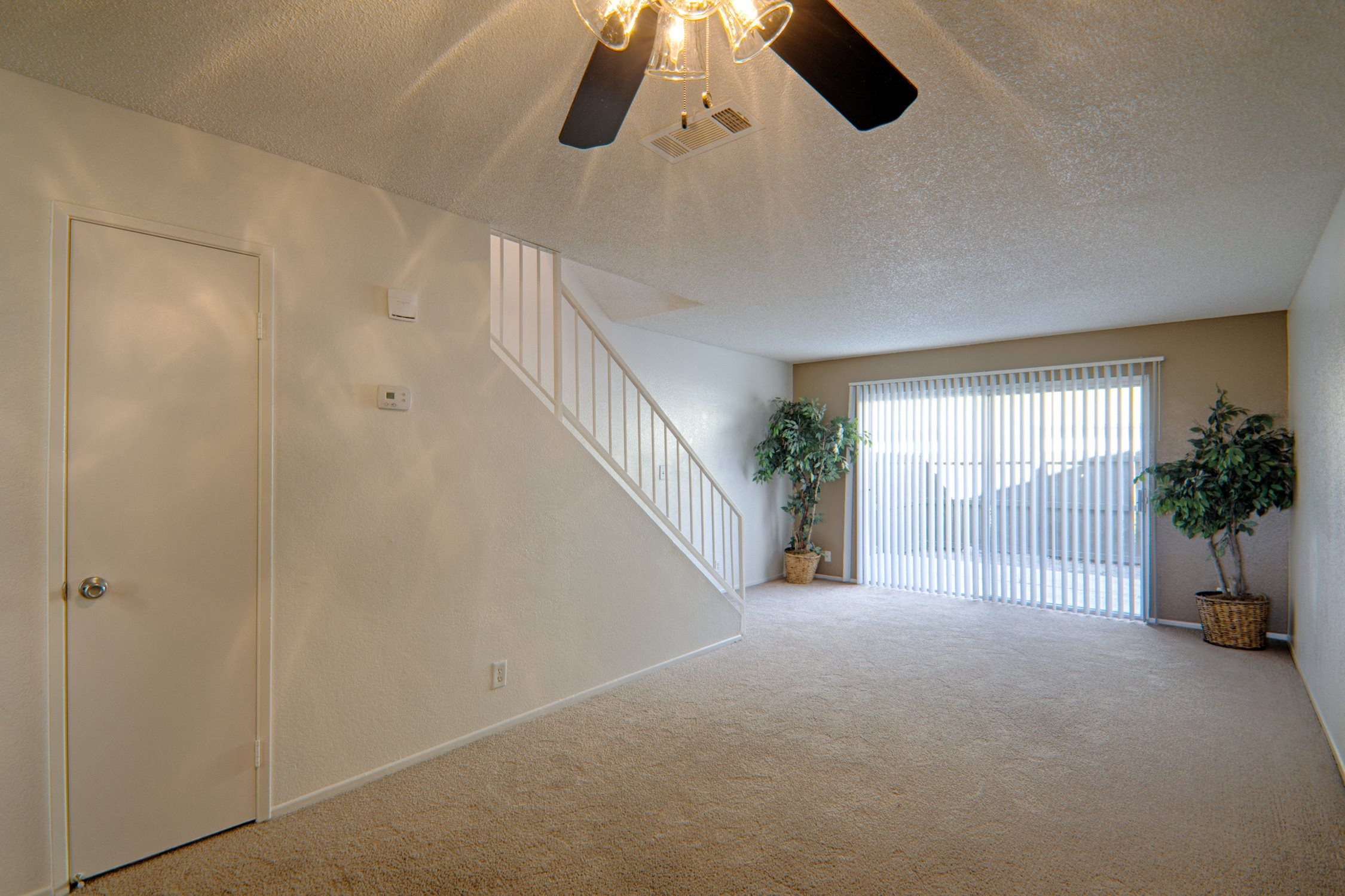 Living Room at Woodlands West Townhomes, Lancaster, CA,93536