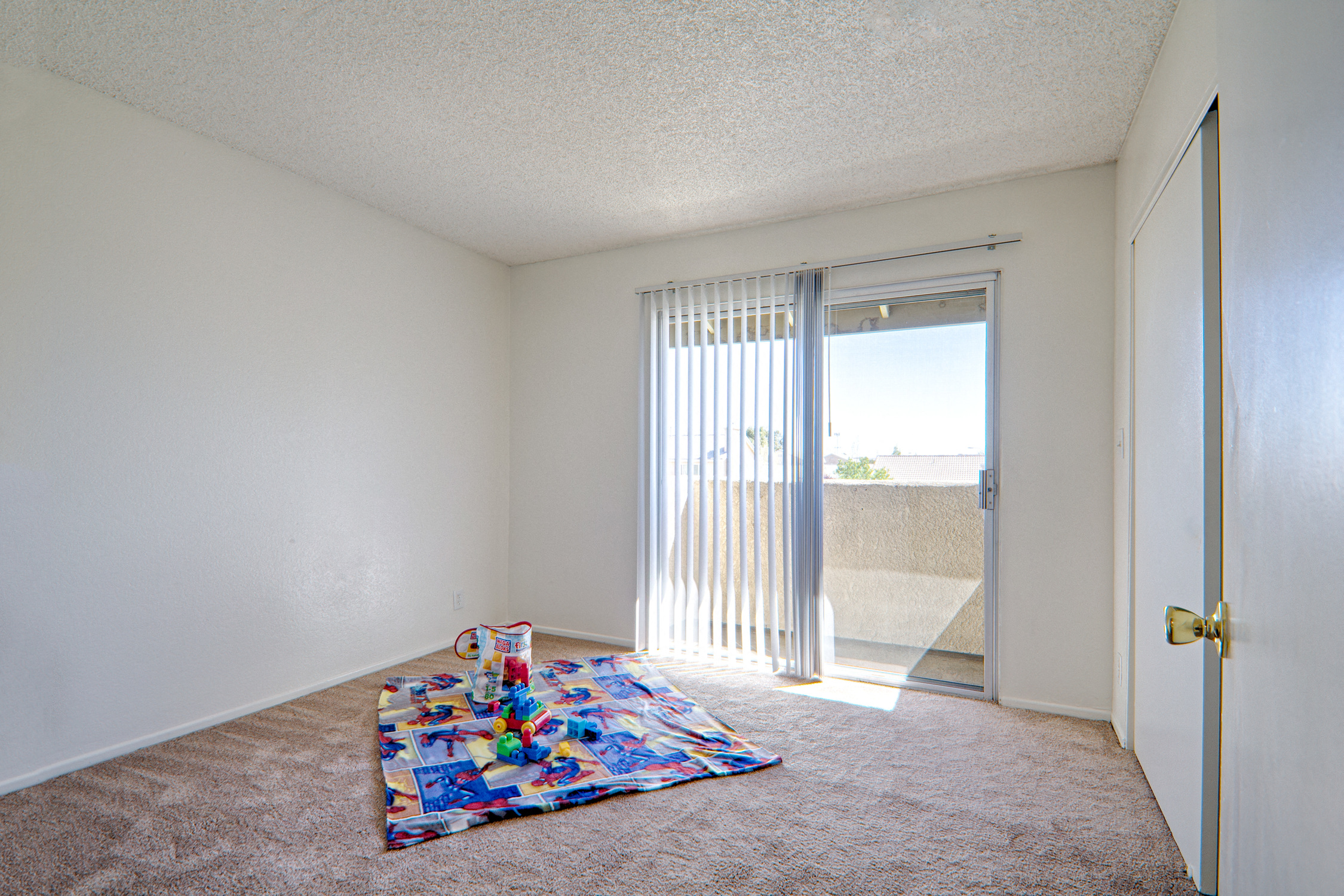 Well-Lighted Guest Bedroom at Woodlands West Townhomes, Lancaster, CA,93536