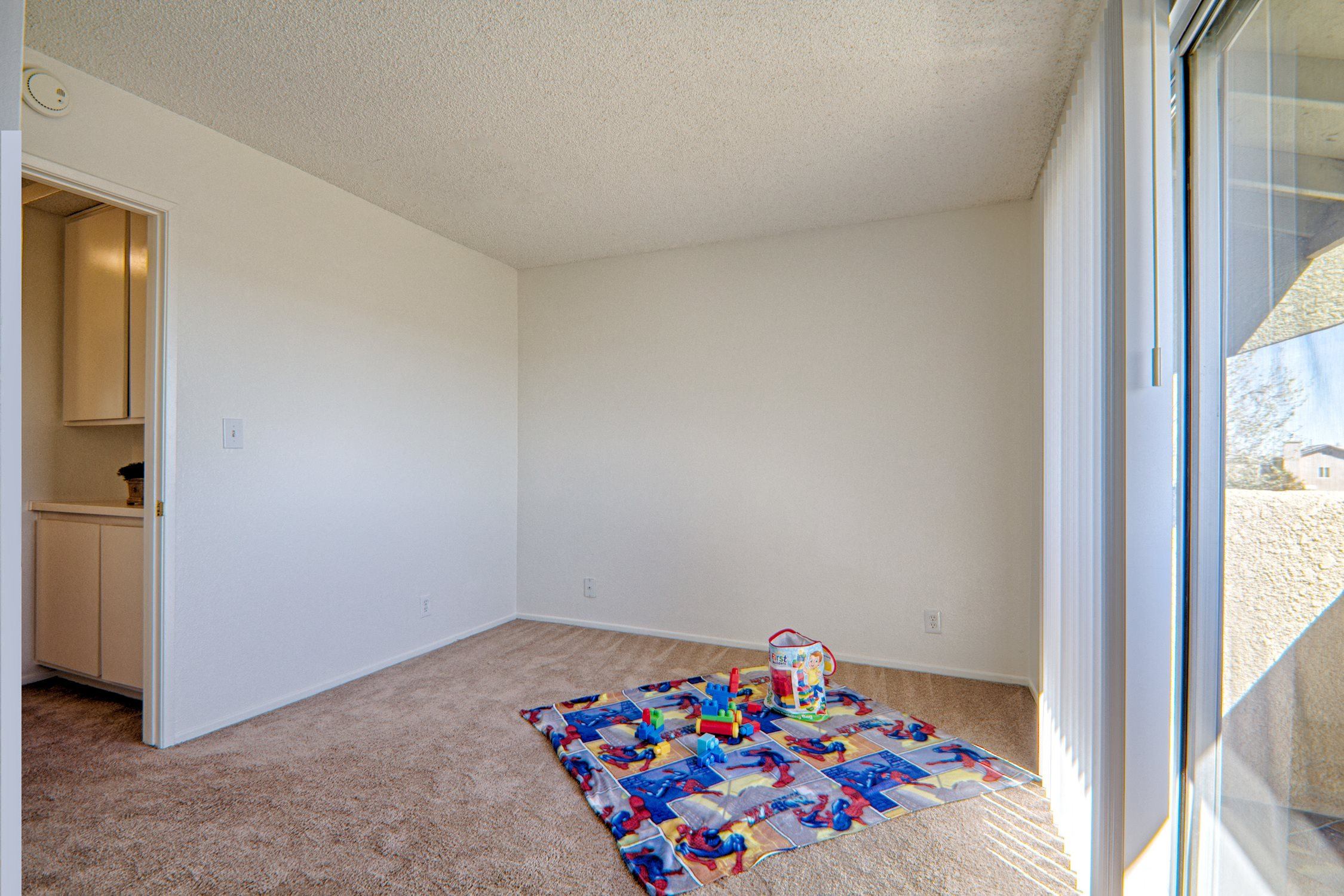 Guest Bedroom with Attached Patio at Woodlands West Townhomes, Lancaster, California