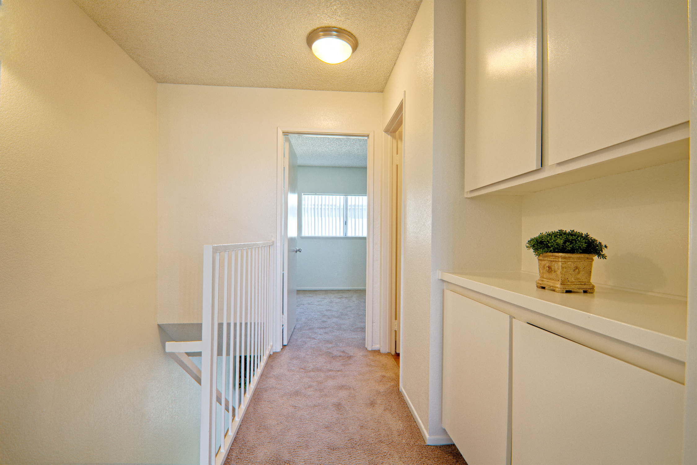 Upper Hallway with Storage at Woodlands West Townhomes, CA, 93536