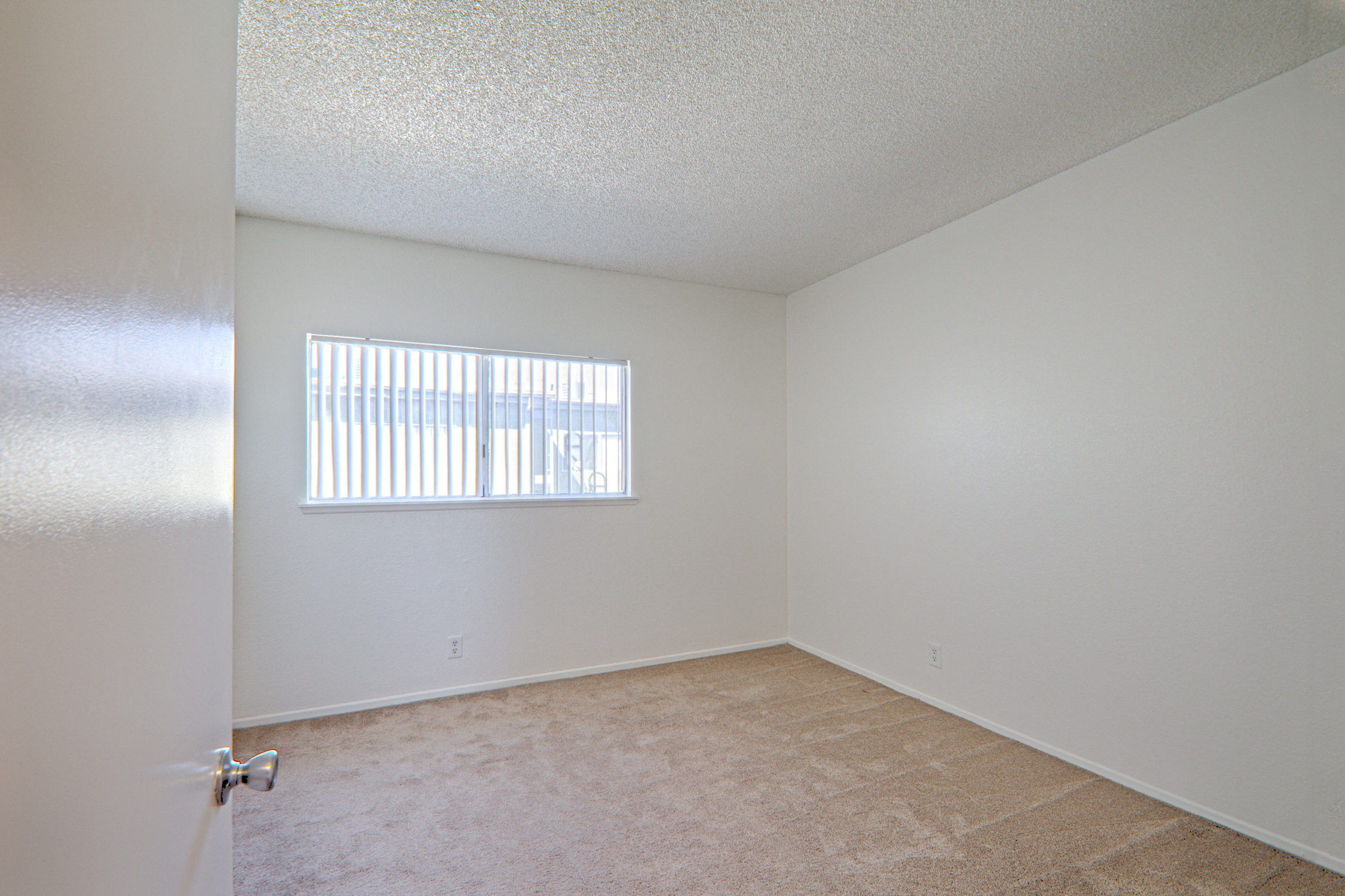 Well-Lighted Bedroom at Woodlands West Townhomes, Lancaster, California