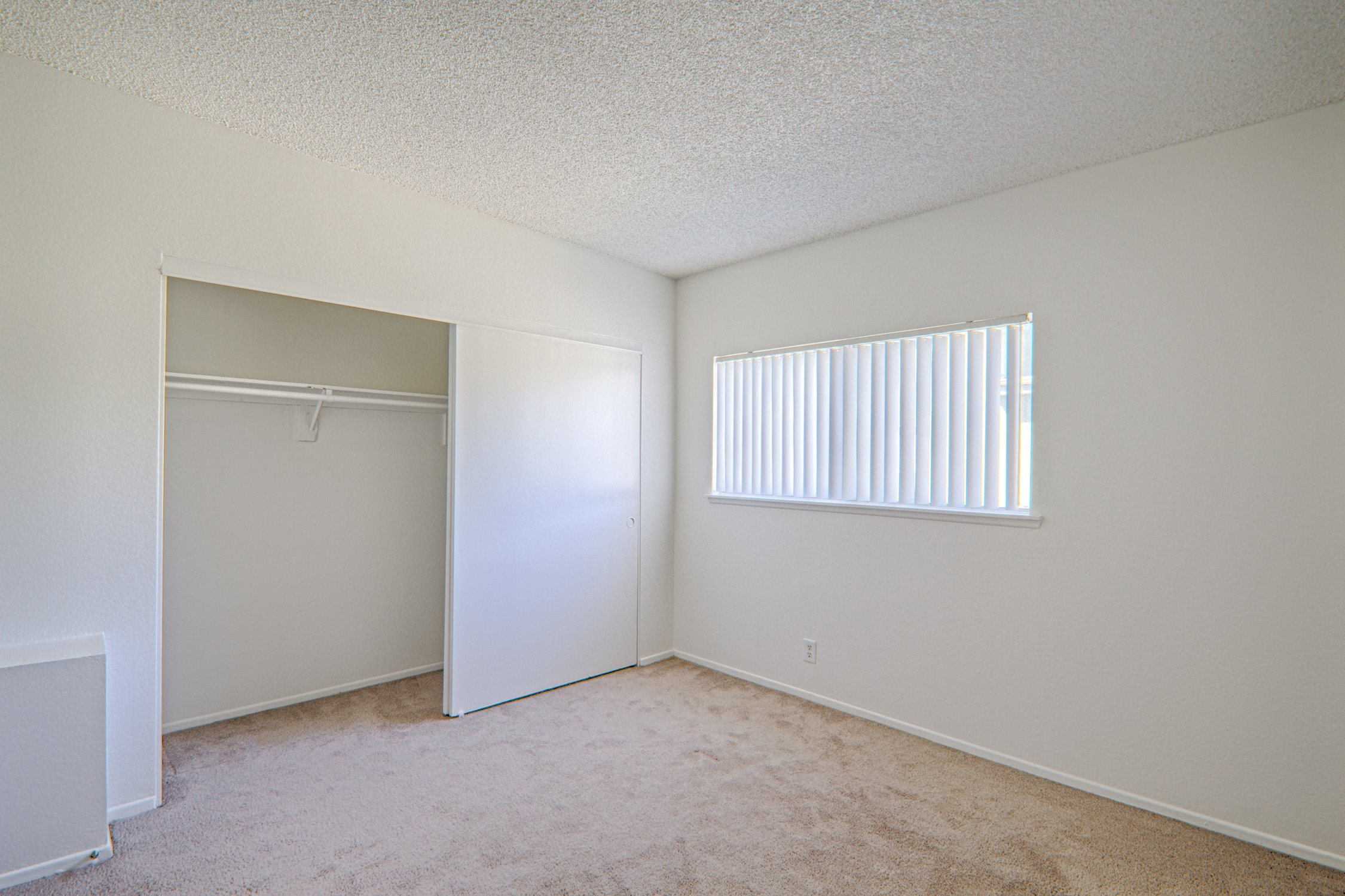 Bedroom with Carpeting at Woodlands West Townhomes, Lancaster, CA,93536