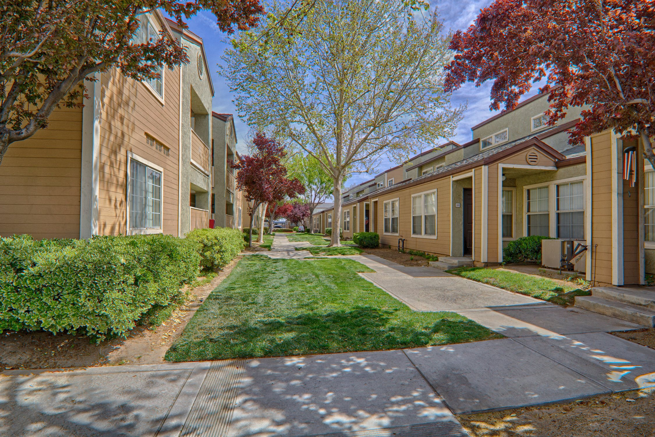 Lush Landscaping at Cordova Park Apartments in CA 93534