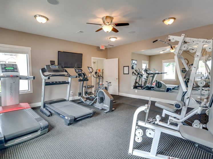 24 hour fitness facility at The Hills Apartments in North Kansas City, MO