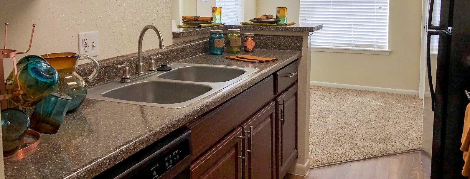 View of kitchen at Piper's Cove Apartments in Webster TX