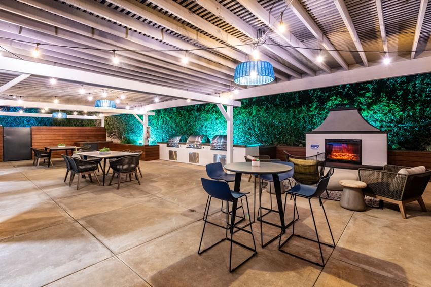 Outdoor grill and fireplace with seating