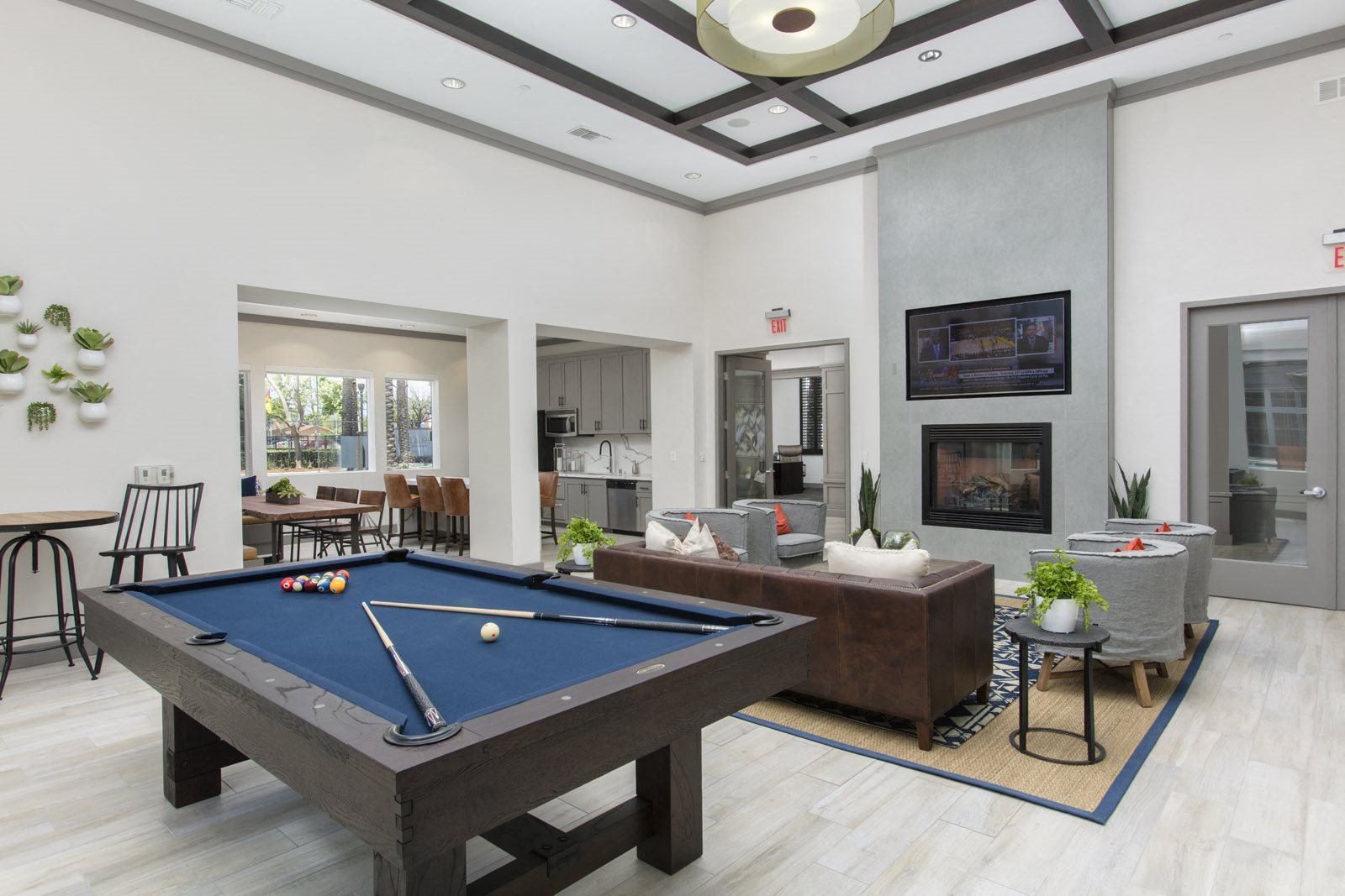 Clubroom with seating area, fireplace, TV, and pool table