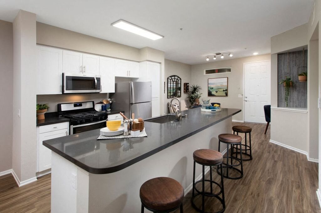 Kitchen with stainless steel appliances and bar seating