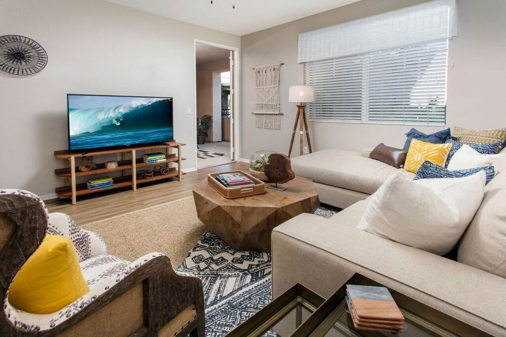 Living area with large windows and TV
