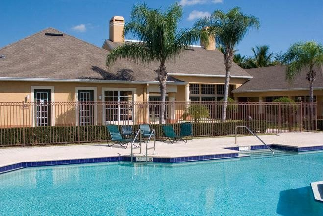 swimming pool with sun decks at Waverly Apts in West Palm Beach FL