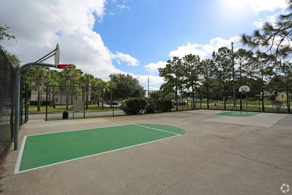 basket ball court at weston oaks apartments in holiday florida