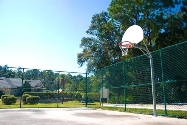 outdoor basketball court at whispering woods apts in st augustine