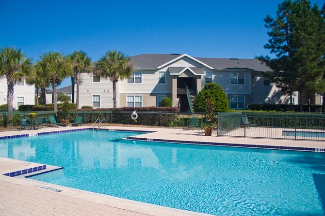 Swimming Pool with Lounge Chairs at Windsong, Lake City, FL