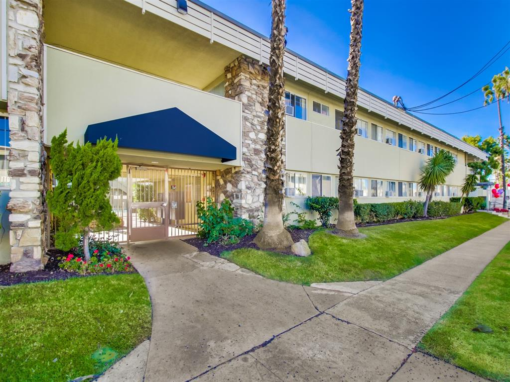 Gated Entrance with Green Belt Paths at Alberts College Apartments, 5460 55th Street, 92115