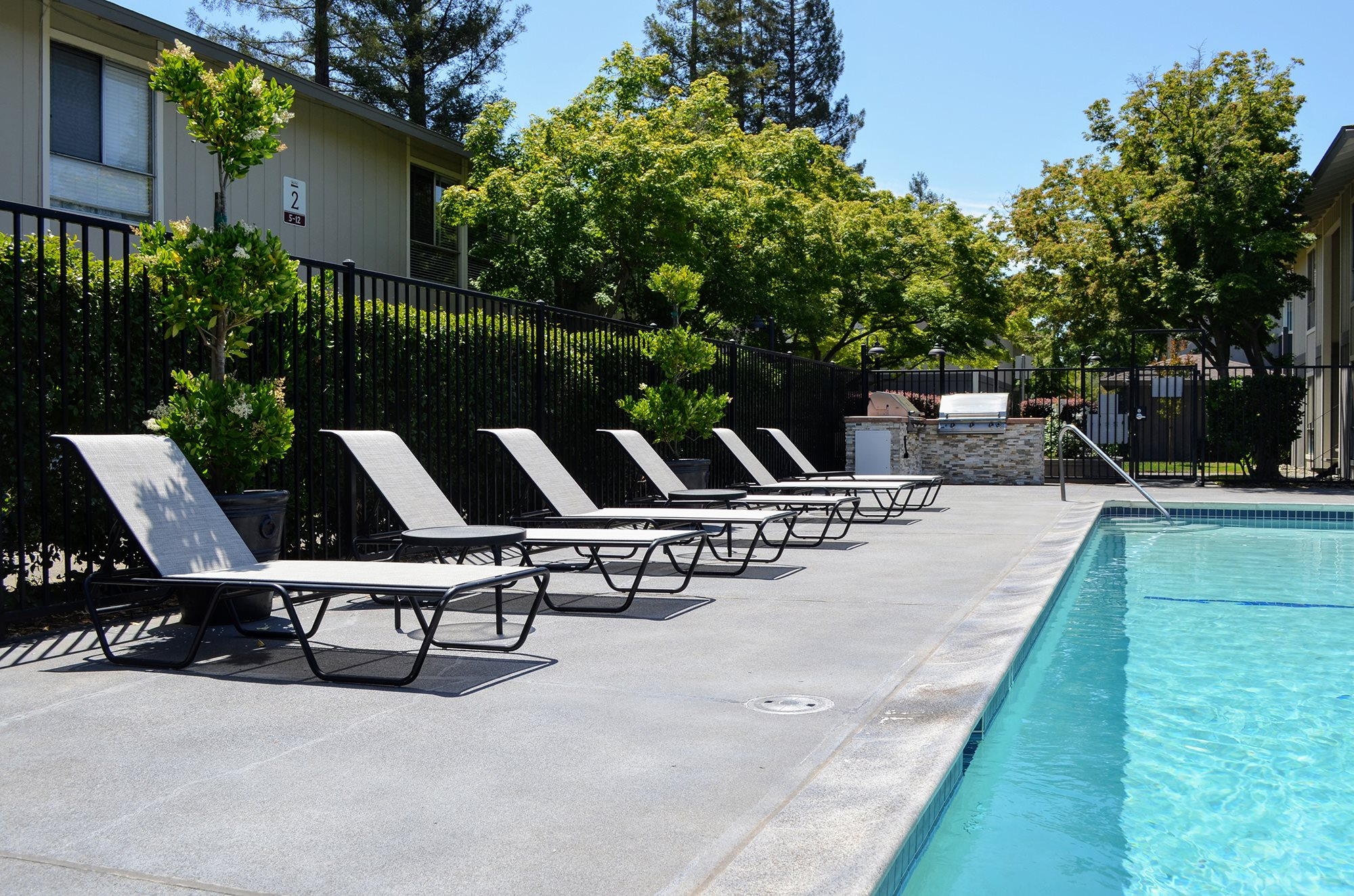Swimming Pool with Lounge Chairs at Bella Vista Apartment Homes, Napa