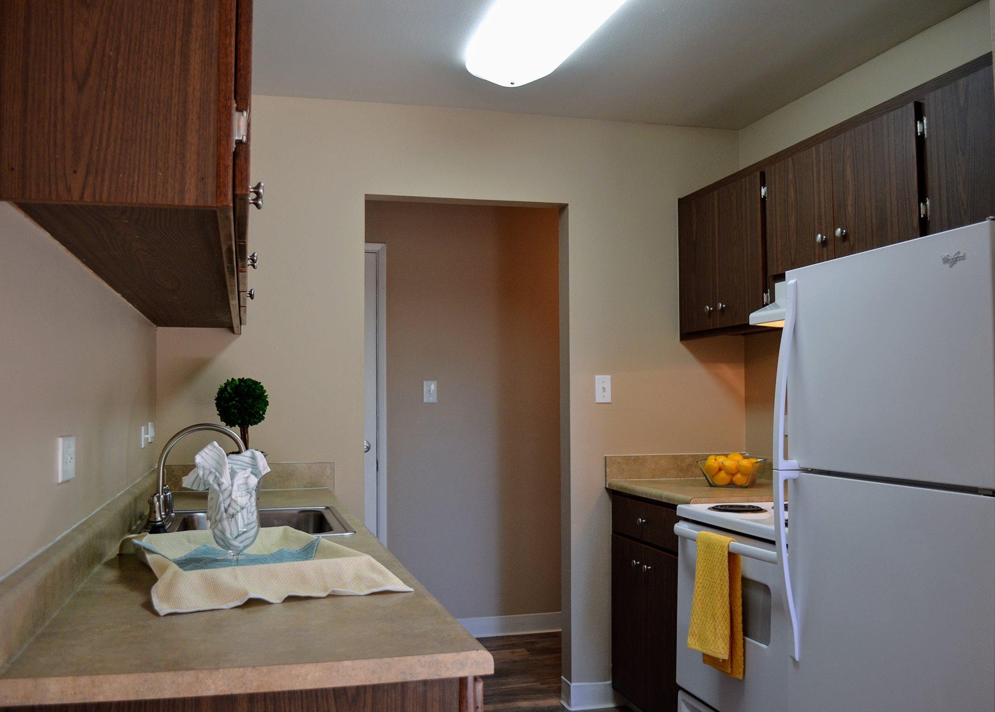 Kitchen with Pantry Cabinet at Bella Vista Apartment Homes, Napa, CA