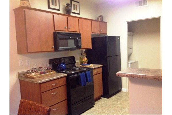 Spacious Kitchen with Pantry Cabinet at Sterling Village Apartments, CA,