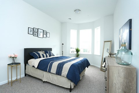 Bedroom model units with carpeted floors white walls