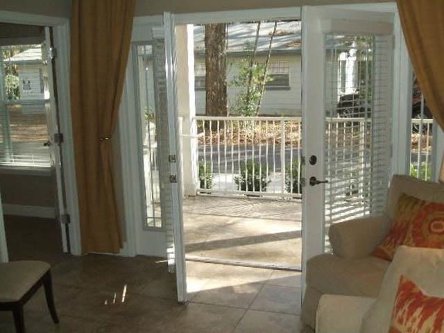 french doors and lots of natural light in living room
