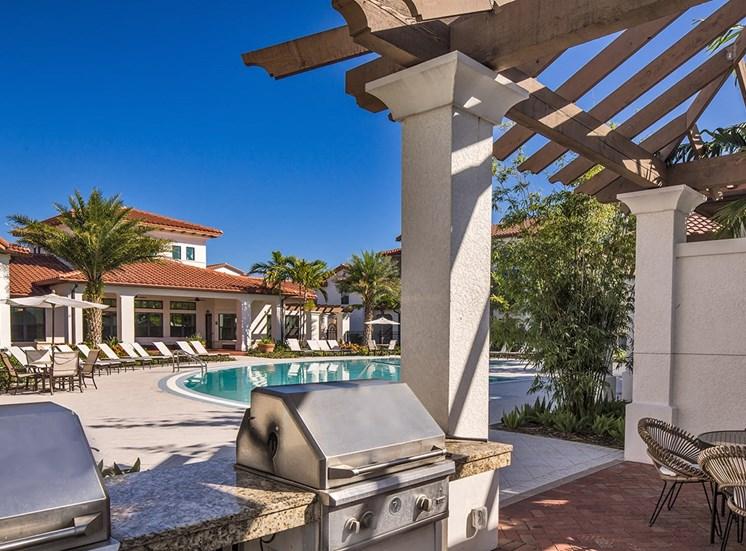 2940 Solano at Monterra apartments poolside BBQ grills in Cooper City, Florida