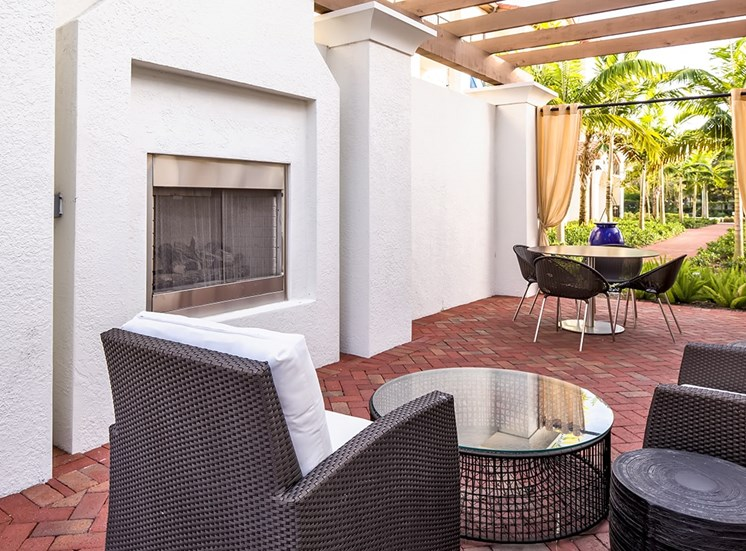 2940 Solano at Monterra apartments poolside outdoor lounge with fireplace in Cooper City, Florida