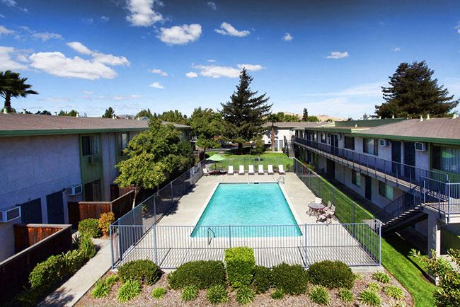 Pool with Lounge Chairs l Autumn Oaks Apts in Suisun City, CA