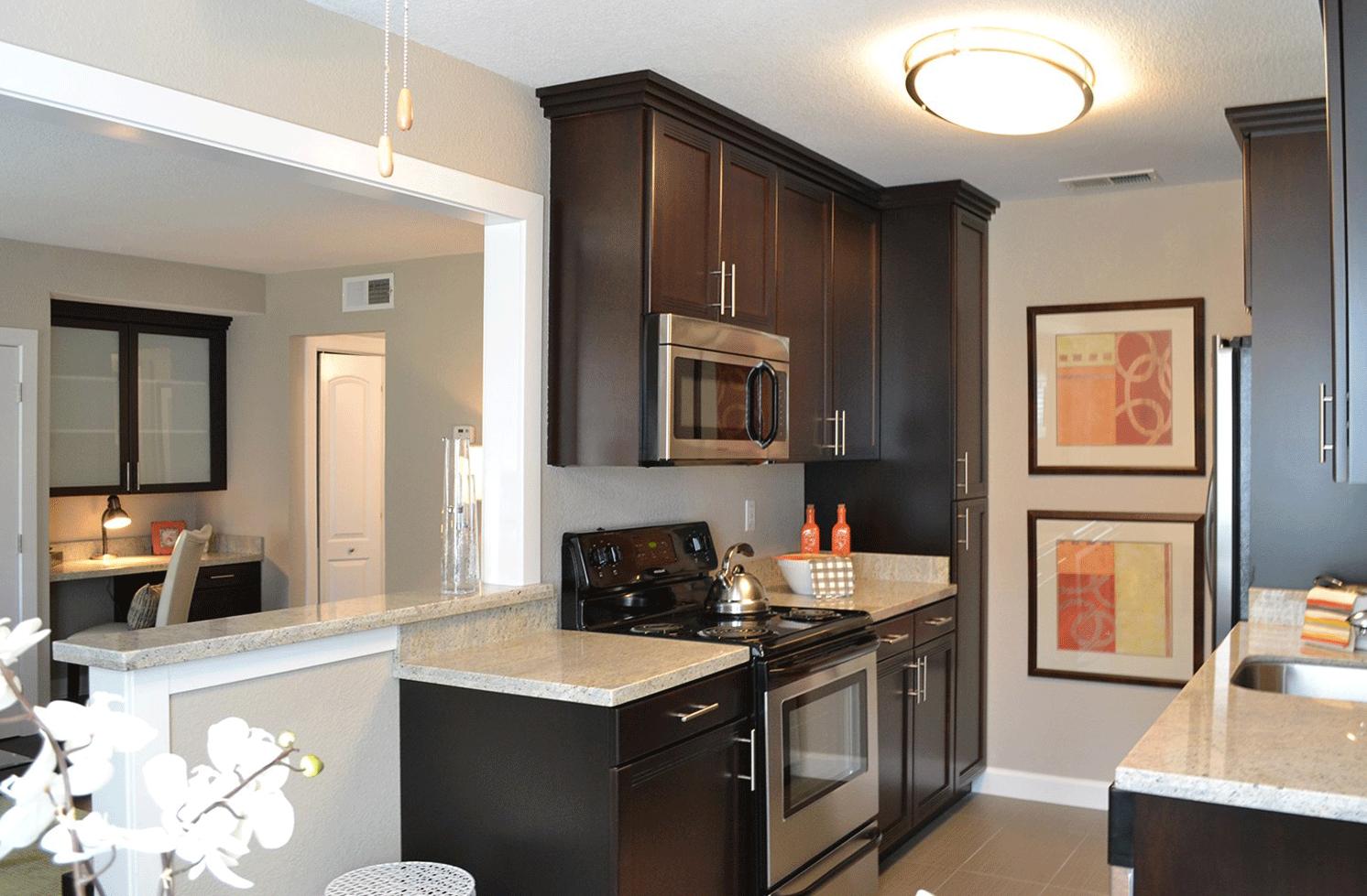 Kitchen with appliances  dining View Rentals at Montecito Villas in Sacramento CA