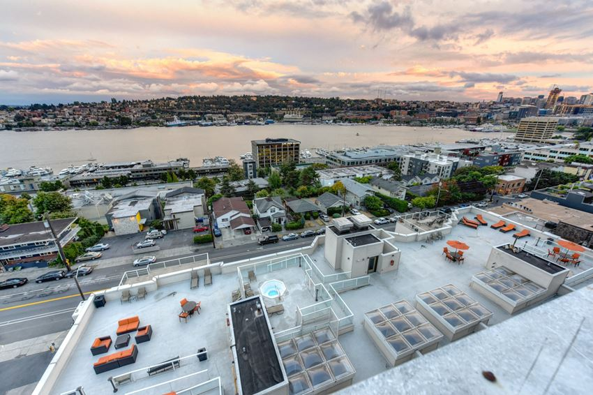 Community Rooftop Lounge Area with View of City, Pink Clouds and Street