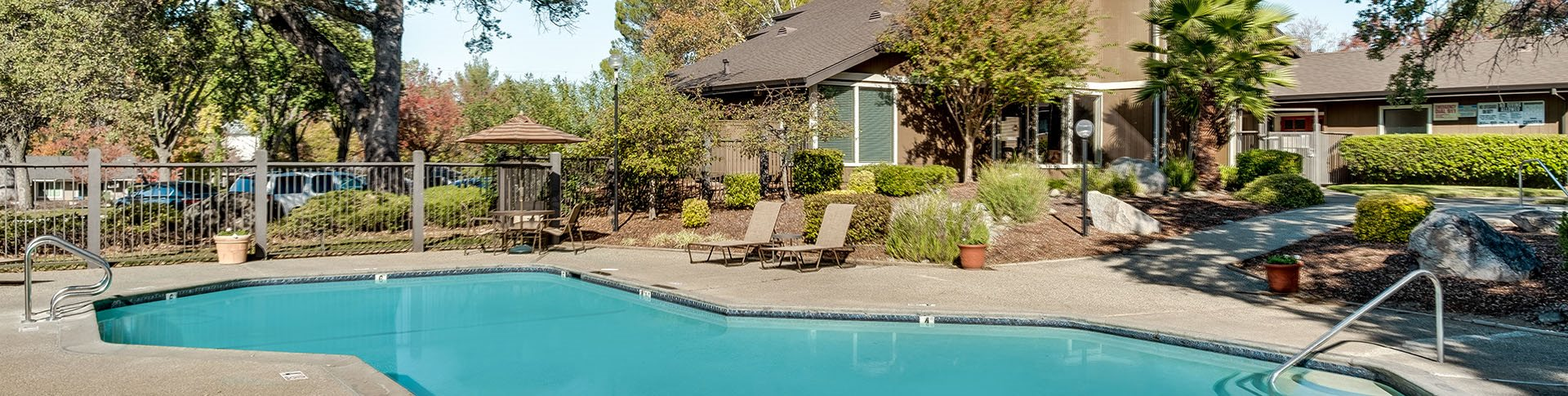 Sutter Ridge Pool with lounge chairs and landscape