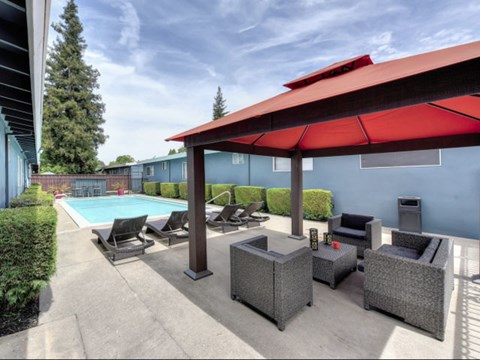 Pool with Lounge Chairs l 1212 Bidwell Apartments in Folsom CA