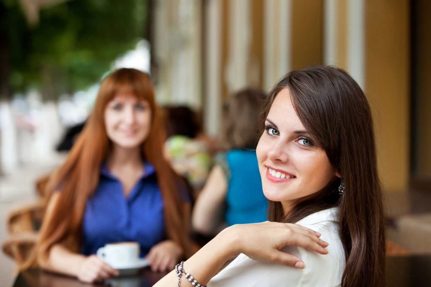 Two girls at outside cafe Vista Ca Apartments For Rent l Taylor Brooke