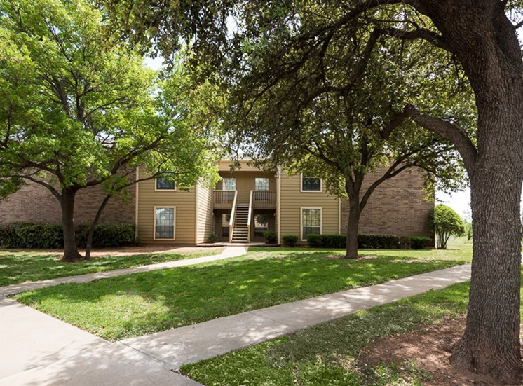 Mature trees at Mill Creek Apartments in Abilene, TX