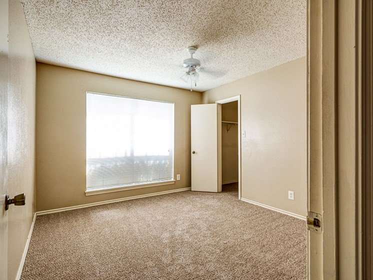 Spacious bedrooms at Mill Creek Apartments in Abilene, TX