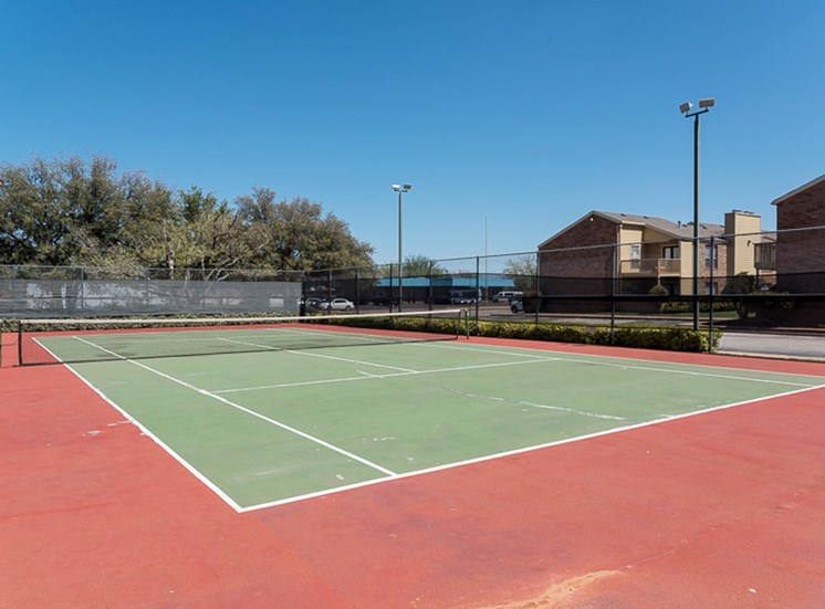 Full tennis court at Mill Creek Apartments in Abilene, TX