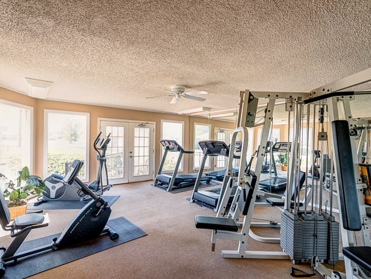 Fully equipped fitness center at Mill Creek Apartments in Abilene, TX