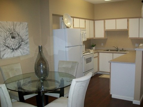 Kitchen and dining   l Vineyard Gate Apartments in Roseville CA
