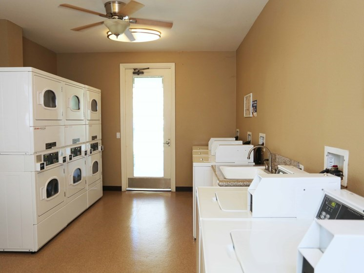 Laundry Facility | Kitchen at Waterstone at Moorpark in Moorpark apts for rent