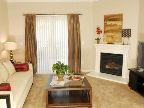 Living room with fireplace Apartments in Modesto, CA l Villas at Villaggio