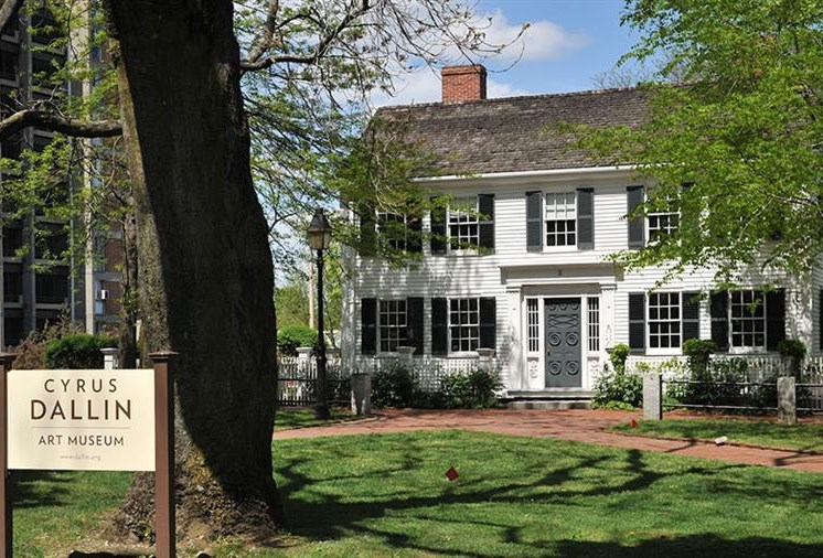 Exterior of Cyrus Dallin Art Museum with green lawn, trees and monument sign - arlington ma luxury apartments
